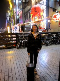my niece (kim) behind  her is one popular takoyaki store  near don quixote