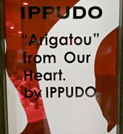a caption at ippudo's glass wall