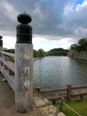 sakuramon bridge at the entrance and the moat surrounding the whole himeji castle complex