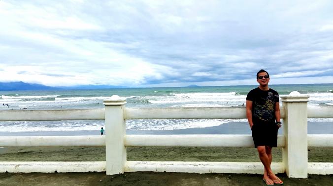 enjoying the sea breeze at the baywalk