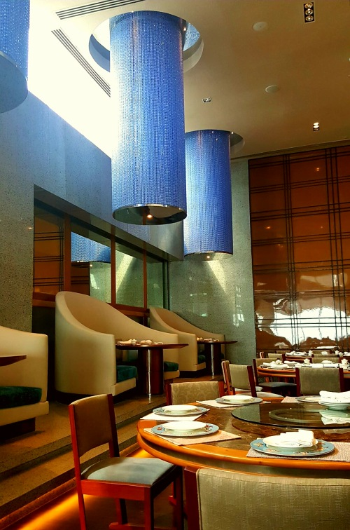 elegant interiors... round chandelier in manila, square chandelier in tokyo...