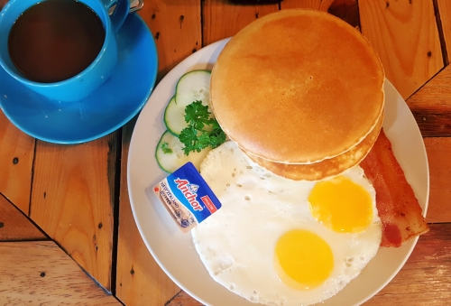 buttermilk pancakes with bacon and eggs