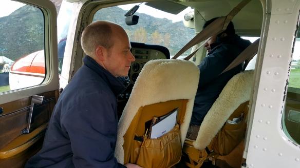 pilot alex assisting denton on his seat...